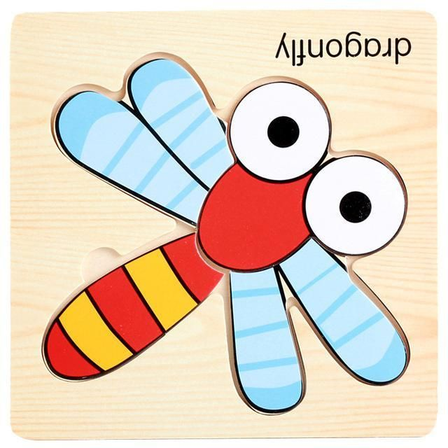 small wooden puzzle dragonfly